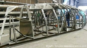 An OVNI 435 aluminum sailboat being framed.