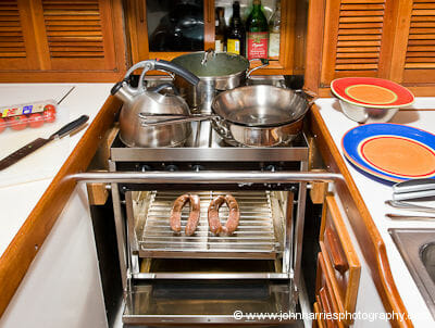 The Force10 marine stove (cooker) in the galley of aluminum expedition sailboat Morgan's Cloud.