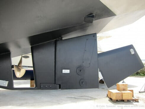 """The lifting rudder arrangement. The lower section is in the raised position, lifted by a hydraulic pump mounted in the starboard cockpit locker, which also controls the centreboard. Like most things on OVNI's it is a simple and very strong set-up. With both plate and rudder raised she only draws around 2'6""""."""