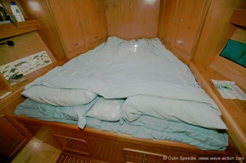 In our view, in order to truly 'live aboard' it is essential to have one cabin which has a full sized double bed. More nights are spent in port for most cruising couples, and it's more than a luxury to have a proper 'bedroom'. Forecabins aren't a lot of use at sea though, and when on passage the cabin becomes a stowage area.