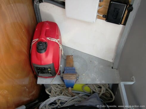 Instead of the standard arrangement of a head and shower compartment forward of the forecabin, we opted for a storage cabin with a small welded workbench. This a cavernous space and swallows up all of our spare sails, warps and anchors. The forward bulkhead is watertight. We have no diesel genset, and our little Honda petrol generator is a useful backup.