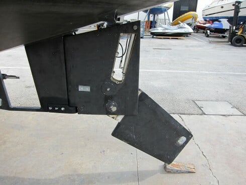The rudder on our OVNI 435, partially lowered. Here, the side plates have been removed to show the internal hydraulic ram used for raising the lower section. The prop is well protected by a full skeg.