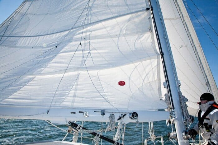 If Phyllis had eased the halyard the full amount of the reef, the sail would have bunched up against the lazy jacks and spreaders, jamming everything solid.