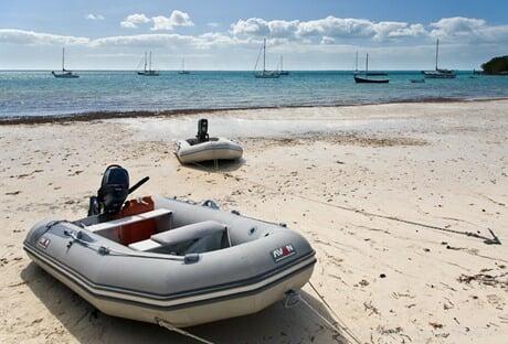 S/V Morgan's Cloud's Avon dinghy hauled up a beach in the Bahamas