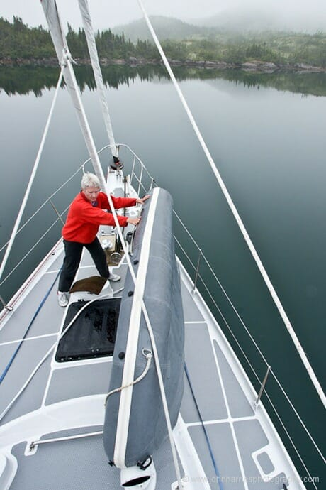 Phyllis moves the Avon dinghy on S/V Morgan's Cloud's foredeck