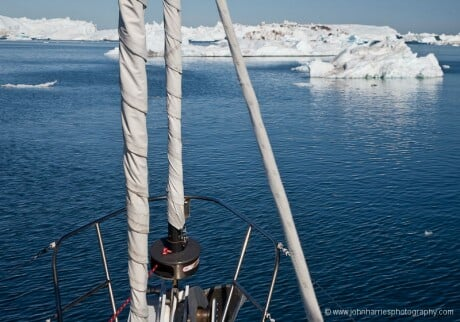 Expedition Sailboat Morgan's Cloud steams through ice in West Greenland