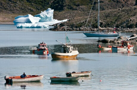 Expedition Sailboat Morgan's Cloud anchored off a West Greenland village