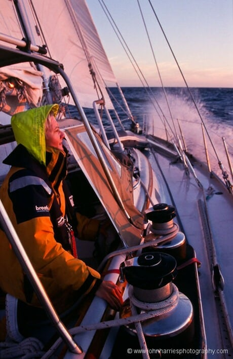 Phyllis Nickel looks out into the sunset during a windward sail in The The Gulf of St Laurence, off the west coast of Newfoundland on `Morgan`s Cloud`.