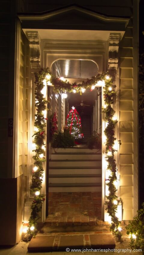"""Something about this lit door and the tree on the piazza (Charleston-speak for porch), just says """"Christmas in Charleston"""". I don't need to add any more information."""
