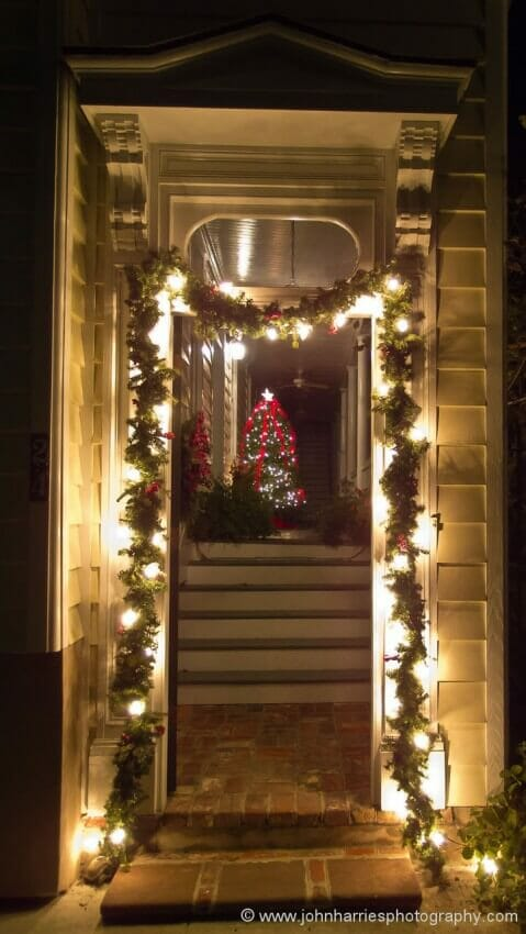 "Something about this lit door and the tree on the piazza (Charleston-speak for porch), just says ""Christmas in Charleston"". I don't need to add any more information."