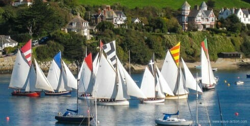 Falmouth working boats line up at the start of an evening's racing.