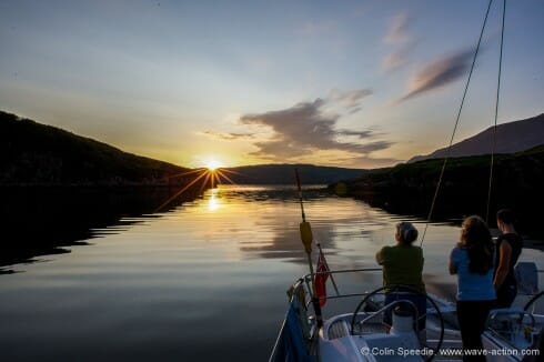The crew watch the sunset from Soay Harbour