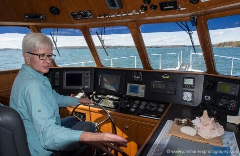 Phyllis checks out the wheelhouse of a Nordhavn 50, the model we liked the best of the several we have looked at for this article.