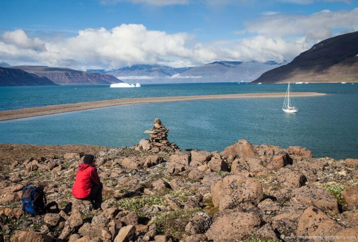"""Phyllis looks out over """"home"""", Greenland west coast 2011."""
