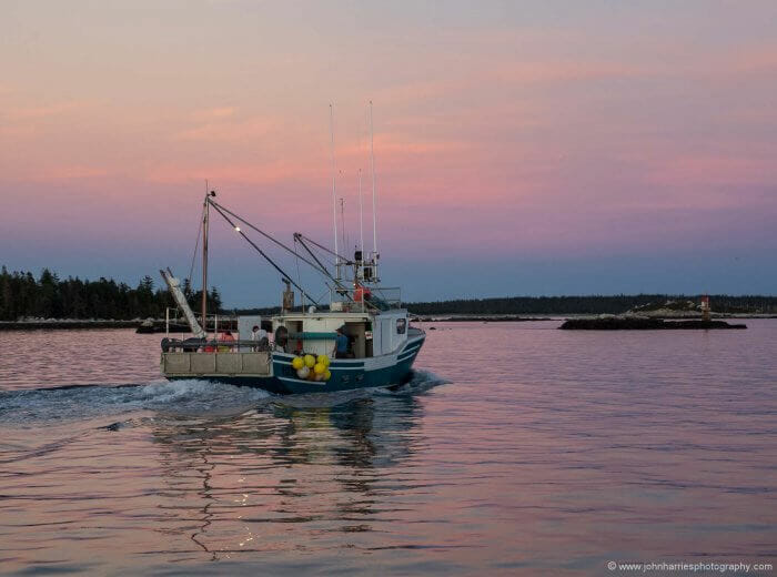 Outbound fishing boat.